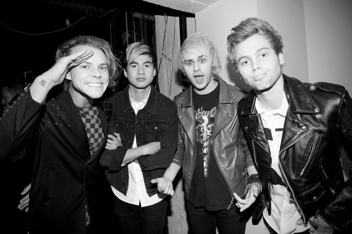 LOS ANGELES, CA - MARCH 29: (Editors Note: This image has been processed using digital filters) Ashton Irwin, Calum Hood, Michael Clifford and Luke Hemmings of the band 5 Seconds of Summer attend the 2015 iHeartRadio Music Awards On NBC on March 29, 2015 in Los Angeles, California. (Photo by Jason Kempin/Getty Images for iHeartMedia)